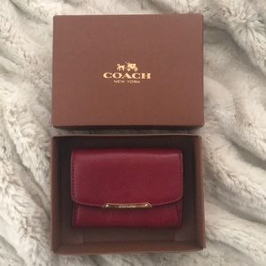 Never been used small red Coach card holder